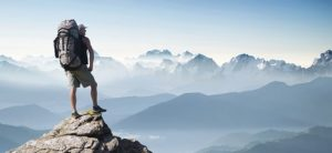 Man on top of mountain over coming his fears