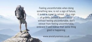 Man on mountain with quote on how to overcome fear