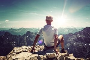 Man on mountain who has overcome depression