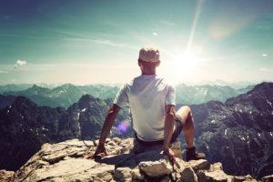 Man on mountain who has overcome depression
