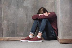 Depressed man thinking negatively