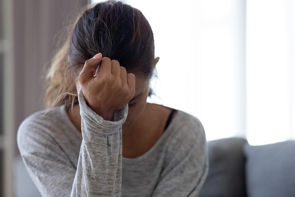 Depressed woman thinking negatively